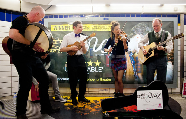West End cast of musical 'Once' busk on London Underground.