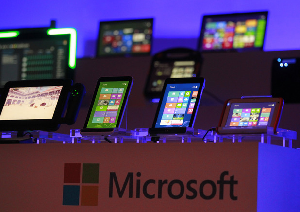 Computing devices running the Microsoft operating systems are seen at the start of Microsoft Corporation's unveiling event of its new operating system upgrade 8.1 at the Computex Taipei 2013