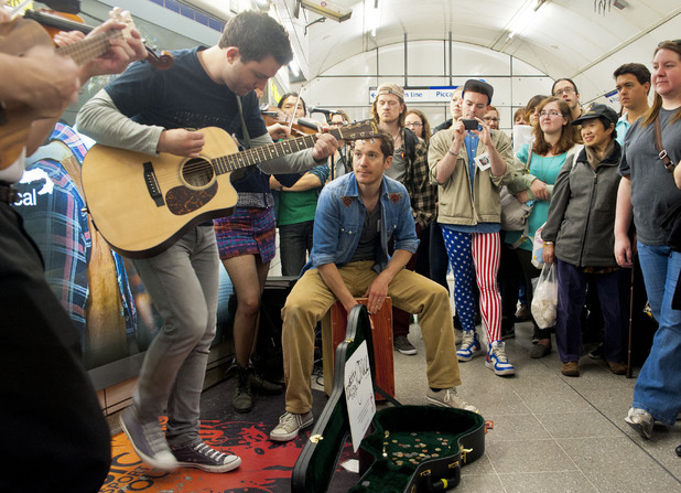 The cast of musical 'Once' busking at Leicester Square station.