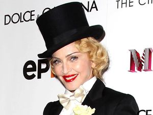 54-year-old singer emulates the style of German actress Marlene Dietrich.