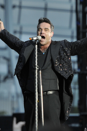 Robbie williams performs at the aviva stadium dublin on the opening