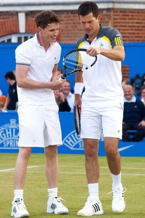 Eddie Redmayne and Tim Henman take part in Rally Against Cancer at the Queen's Club, London