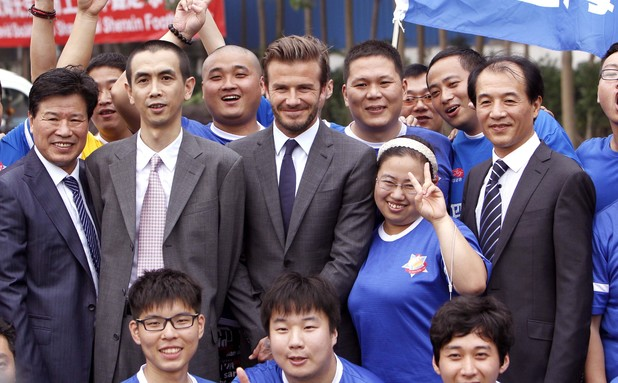 David Beckham with fans at Shanghai Shenxin Football club