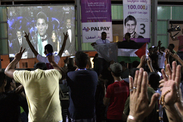 Palestinians celebrate after Palestinian singer Mohammed Assaf was declared the winner of Arab Idol.