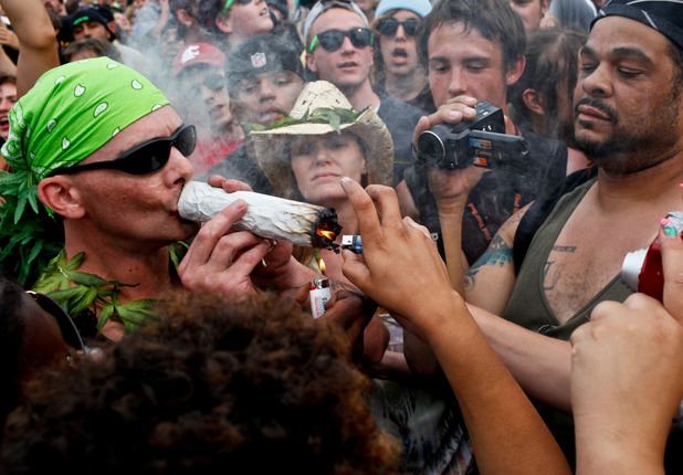 People smoke a joint at Hempfest 2012