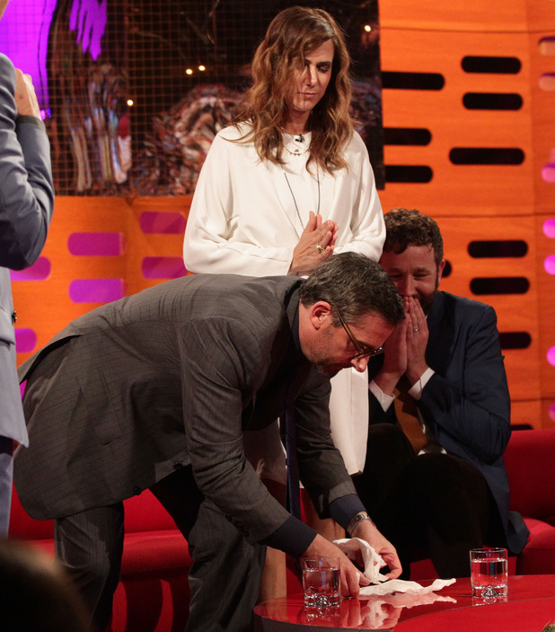 Guests Steve Carell and Kristen Wiig react after Chris O'Dowd found a fly in his drink, during filming of The Graham Norton Show
