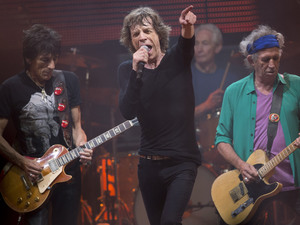 Mick Jagger, Ronnie Wood, Charlie Watts, and Keith Richards of the Rolling Stones, perform on the Pyramid main stage at Glastonbury.