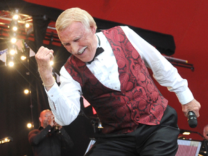 Sir Bruce Forsyth arrives on the Avalon stage.