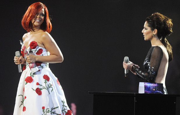 Cheryl Cole (right) presents the International Female Award to Rihanna (left) on stage during the 2011 Brit Awards at the O2 Arena, London.