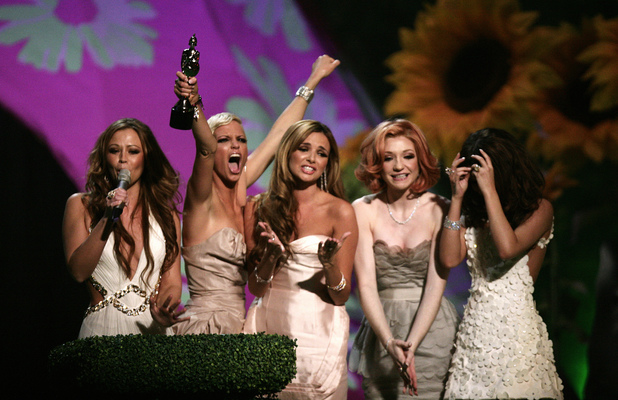 Girls Aloud collect their award for British Single on stage, during the BRIT Awards