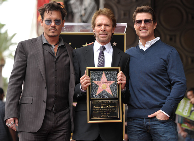 Johnny Depp, Jerry Bruckheimer and Tom Cruise  appear at a ceremony honoring film producer Jerry Bruckheimer with a star on the Hollywood Walk of Fame on Monday, June 24, 2013 in Los Angeles.