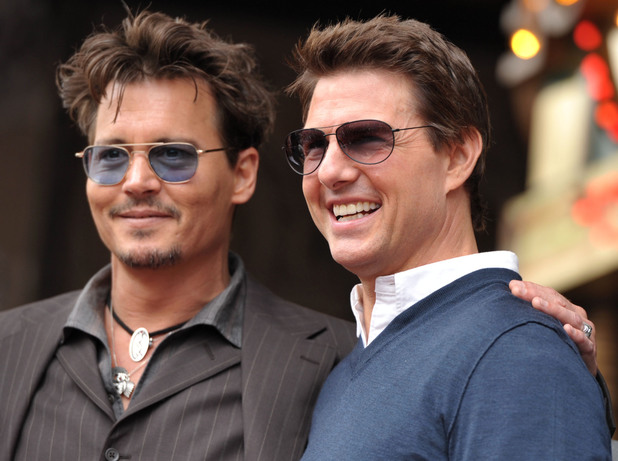 Johnny Depp and Tom Cruise appear at a ceremony honoring film producer Jerry Bruckheimer with a star on the Hollywood Walk of Fame on Monday, June 24, 2013 in Los Angeles.
