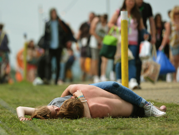 A couple get amorous at Glastonbury Festival 2013