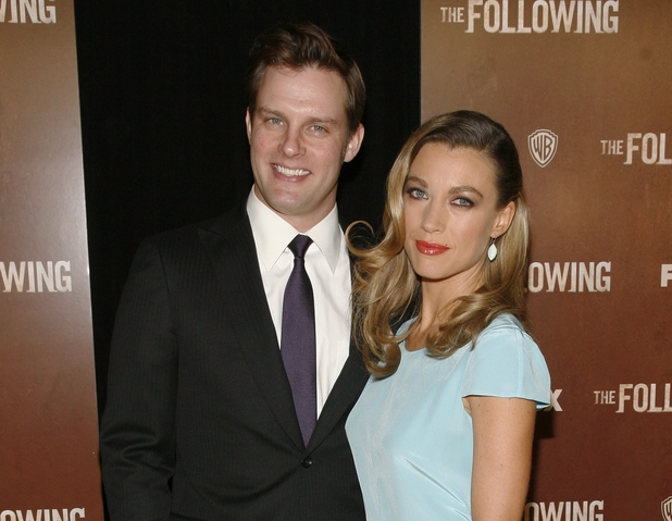 "Actor Travis Schuldt, left, and actress Natalie Zea, right, attend the world premiere of ""The Following,"" at the New York Public Library on Friday, Jan. 18, 2013 in New York."