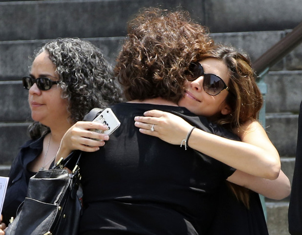 Jamie Lynn Sigler, right, is embraced as she leaves the Cathedral Church of Saint John the Divine after the funeral service for James Gandolfini, Thursday, June 27, 2013 in New York.