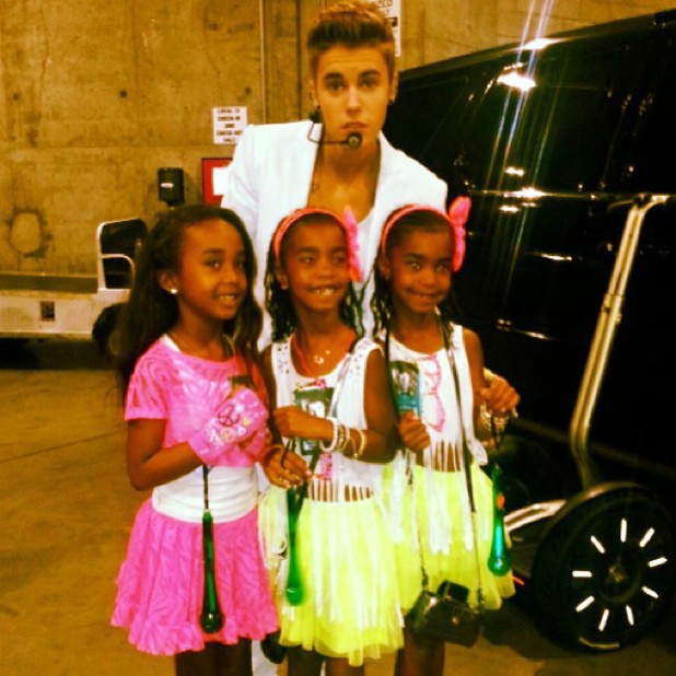 Justin Bieber poses with P Diddy's daughters