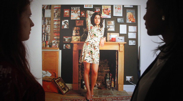 People view the Amy Winehouse: A Family Portrait exhibition at the Jewish Museum in London.