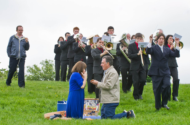 A brass band appears and Bob proposes to Brenda.