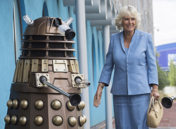 Camilla Duchess of cornwall poses with a Dalek