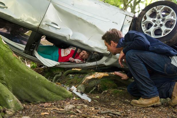 Cameron talks to a trapped Gennie.
