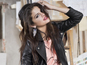 Selena Gomez in leather jacket, hot pants