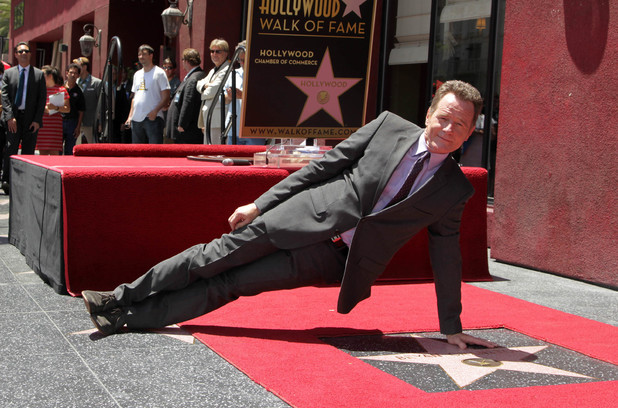 Bryan Cranston does one-armed push-ups over his Hollywood Walk of Fame star