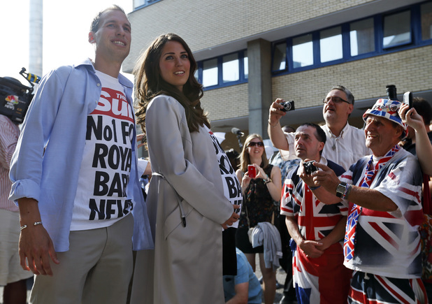 Members of the media film a couple impersonating Britain's Prince William and Kate, the Duchess of Cambridge during a publicity stunt.