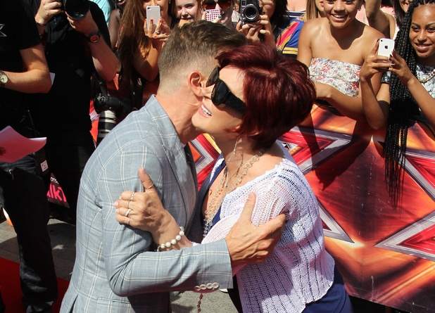 Gary Barlow and Sharon Osbourne arriving at The X Factor 2013 auditions at Wembley Stadium