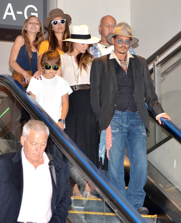 Johnny Depp and family at Narita International Airport