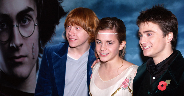 Daniel Radcliffe, right, actress Emma Watson, and Rupert Grint, left, stand in front of the film's poster, in London's Leicester Square for the premier of their latest Harry Potter film, 'Harry Potter and the Goblet of Fire, 2005