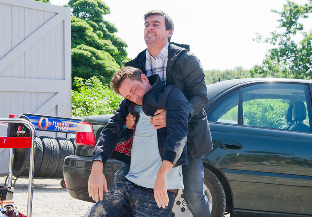 Cain drags Cameron to his car.