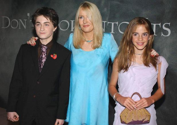 Daniel Radcliffe, who plays Harry Potter (left) with the characters creator JK Rowling (centre) and co-star Emma Watson as they arrive for the celebrity film premiere of Harry Potter and the Chamber of Secrets at the Odeon Leicester Square