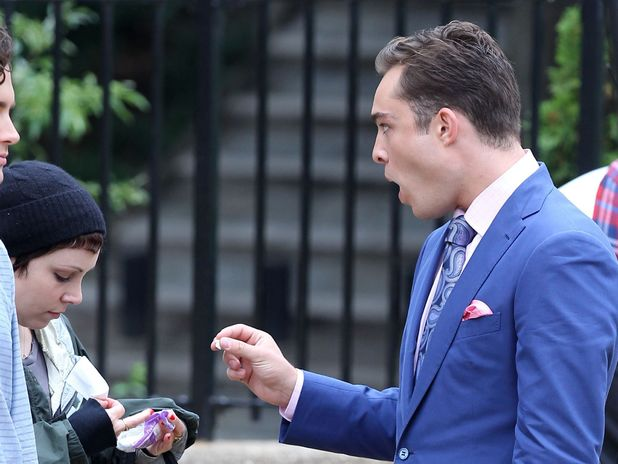 'Gossip Girl' on set filming, New York, America - 16 Aug 2011 Ed Westwick handing his gum to a make-up assistant