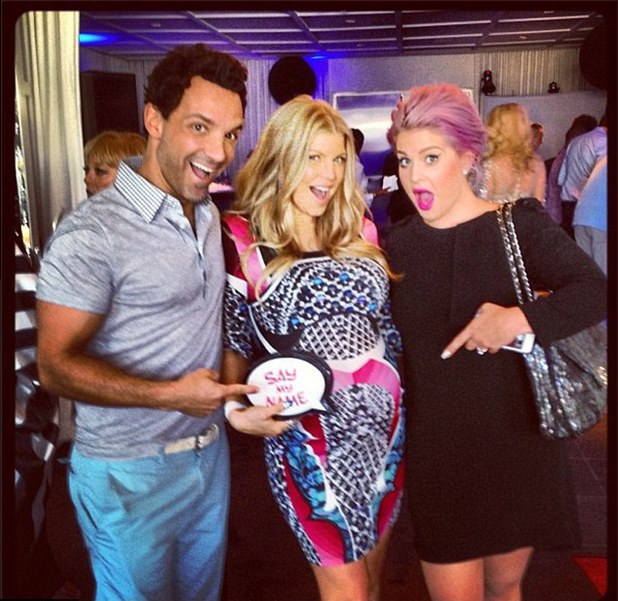 Fergie poses with George Kotsiopoulos and Kelly Osbourne