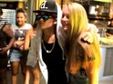 Fans scream and take photos with the doppelgänger Bieber near his concert.