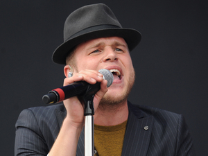 Olly Murs performs on the Virgin Media stage during day one of the V Festival at Weston Park