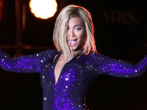 Beyonce performing on the Virgin Media Stage during day one of the V Festival at Hylands Park in Chelmsford.