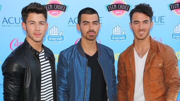 The Jonas Brothers arriving at the Teen Choice Awards 2013