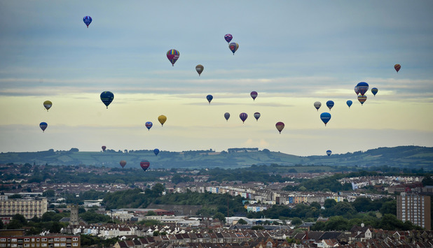 Hot air balloons passing over Bristol