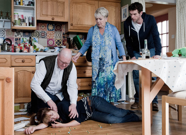 Paddy finds Rhona unconscious.