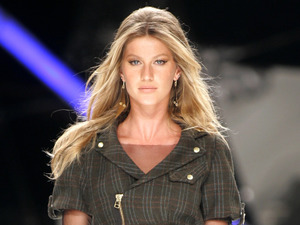 Top model Gisele Bundchen wears part of the Colcci fall-winter fashion collection