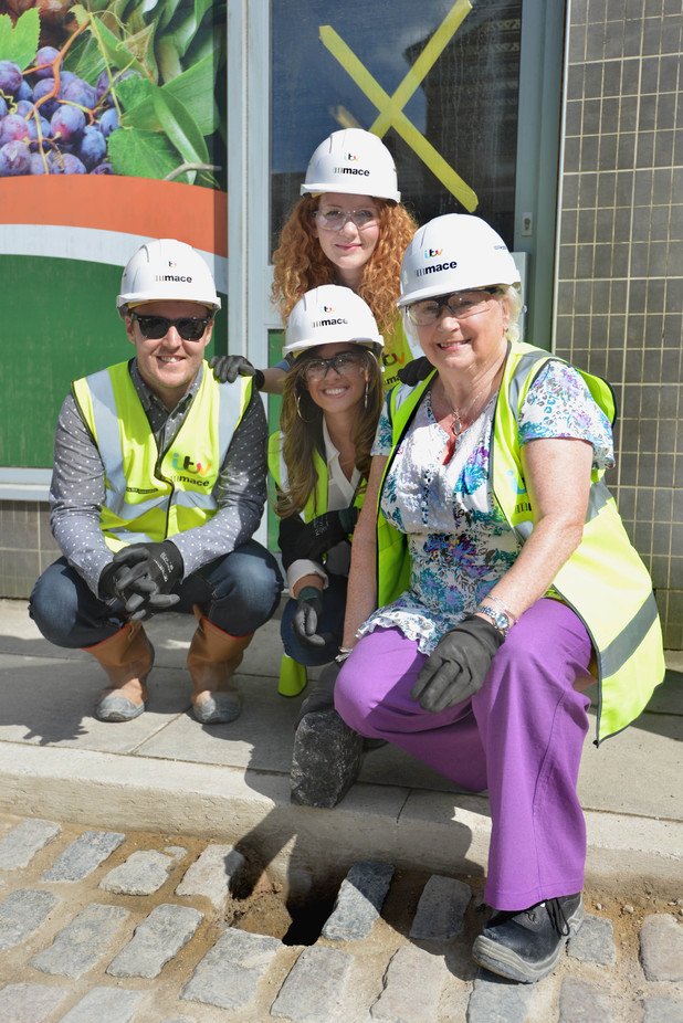 Denise Thomas lays the final cobble at the new Coronation Street set
