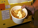 The dispenser in Belgium produces hot chips using a unique cooking technique.