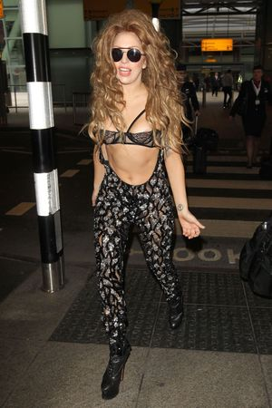 Lady Gaga arriving at Heathrow airport 27 Aug 2013