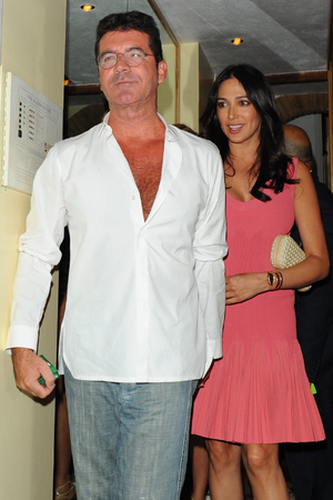 LONDON, UNITED KINGDOM - AUGUST 28: Louis Walsh, Lauren Silverman and Simon Cowell sighting at Scalini Restaurant, Chelsea on August 28, 2013 in London, England.