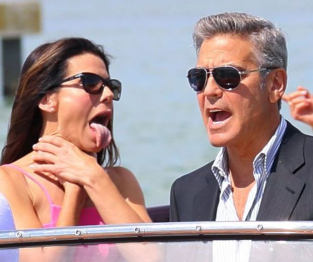70th Venice International Film Festival, Italy - 28 Aug 2013 George Clooney, Sandra Bullock arrive in a boat