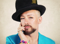 Boy George bemoans Holyfield gay remarks