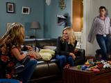 Alfie walks in to find Ronnie with Roxy and Tommy.