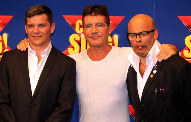 Nigel Harman, Simon Cowell and Harry Hill at a photo-call at RADA in London to launch the X Factor Musical 'I Cant sing'.