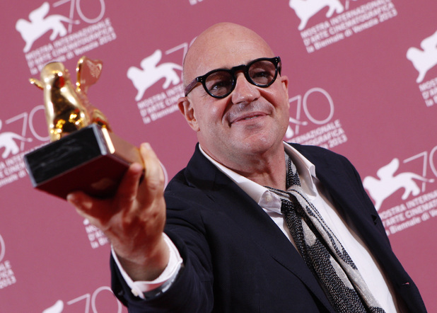 Gianfranco Rosi with his Golden Lion for Sacro Gra